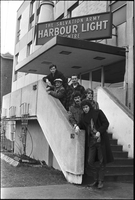 Image of City Muffin Boys standing on the steps of the Salvation Army Harbour Light Centre.