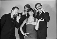 Image of the Dirty Shames rock band posing for a formal portrait with Amos Garrett and James McCarthy using Carol Robinson's hair as mustaches.