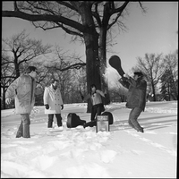 The Dirty Shames rock band playing in the snow in Queen's Park with Amos Garret hitting a snow ball with his instrument case.