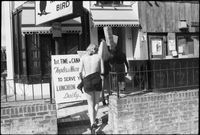 Women protest higher wages for male nude staff in front of the Mynah Bird coffeehouse in Yorkville.