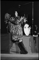 Cass Elliot clapping her hands in performance with The Mamas and the Papas at Maple Leaf Gardens [negative broken at the top]