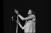 Michelle Phillips in performance with The Mamas and the Papas at Maple Leaf Gardens [negative is broken on left side]