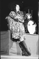 Cass Elliot with arms crossed in performance with The Mamas and the Papas at Maple Leaf Gardens