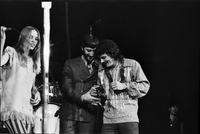 Michelle Phillips (right), Denny Doherty (centre) and Scott McKenzie (right) in performance with The Mamas and the Papas at Maple Leaf Gardens