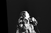 Cass Elliot in performance with The Mamas and the Papas at Maple Leaf Gardens [negative is broken on left side]