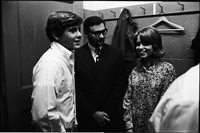 Desi Arnaz, Jr. (white shirt) with a young woman and bearded man - backstage at Maple Leaf Gardens.
