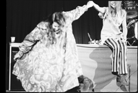 Cass Elliot (left - taking a bow) and Michelle Phillips (right) in performance with The Mamas and the Papas at Maple Leaf Gardens [negative is broken on left side]