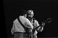 "Billy Hinsche (left) and Dean ""Dino"" Paul Martin Jr. (right) of Dino, Desi and Billy in performance at Maple Leaf Gardens - opening for The Mamas and the Papas [negative is broken on left side]"