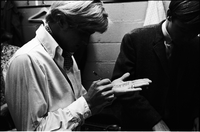 "Dean ""Dino"" Paul Martin, Jr. (white shirt) writing set list on his hand backstage at Maple Leaf Gardens."