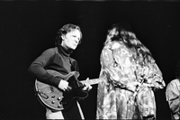 Cass Elliot interacting with guitarist in performance with The Mamas and the Papas at Maple Leaf Gardens