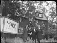 Robert Winters (left), Murrary Ross (right) next to the York University sign in front of Falconer Hall (University of Toronto).