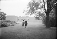Lois Henry and a male student on the grounds of the Glendon campus, York University.