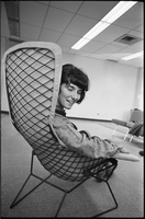 Linda Pelleterio sitting in a chair turning to face the camera.