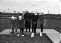 Five men, using four shovels at the sod turning for Keele Campus.