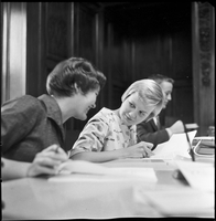 Two female students registering for university, Janet Beeby is facing camera; Lois Henry is not.