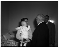Prime Minister St. Laurent in conversation with mother and child