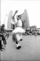 Musicians play, while Greek dancer in fustanella costume, performs on stage at Nathan Phillips Square outside Toronto City Hall