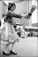 Greek dancers, in national costume, perform on stage at Nathan Phillips Square outside Toronto City Hall