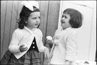 Two young girls with Easter eggs.