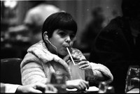 Annabelle Lopes, has a drink in the cafeteria, at Toronto International Airport in Malton.