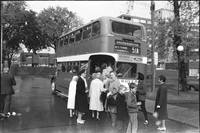 Alexandra Park residents prepare to board the borrowed double decker bus organized to take them to a Food City supermarket outside their neighbourhood.