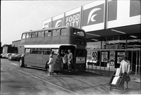 The borrowed double decker bus, carrying people from Alexandra Park, arrives at Food City supermarket.