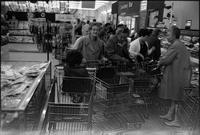 A group of elderly women, bussed in from Alexandra Park, including Ruby Davis and Jennifer Garven, using shopping carts at the Food City supermarket.