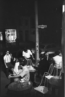 An evening crowd at outdoor cafe tables of a Yorkville coffee house at the corner of Yorville & Hazelton [possibly The Mynah Bird].