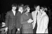 "Image of The Beatles standing and speaking to a female reporter left to right: John Lennon, George Harrison, Michele Finney of CBC's ""Razzle Dazzle"", Paul McCartney and Ringo Starr."