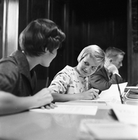 Three students registering for university, Lois Henry (left), Janet Beeby (right), and Doug Rutherford (background).