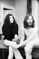 Yoko Ono and John Lennon seated together [at King Edward Hotel].