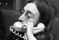 John Lennon on the telephone while at the home of Ronnie Hawkins.