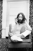 John Lennon seated alone [at King Edward Hotel].