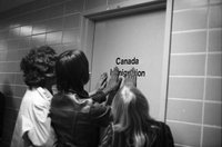 Fans of John Lennon,with their hands on the door of Canada Immigration office, at Toronto International Airport.Fans of John Lennon,with their hands on the door of Canada Immigration office, at Toronto International Airport.