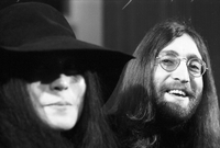 Yoko Ono (out of focus) and John Lennon [at Ontario ScienceCentre].