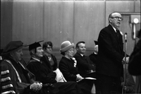 The Right Honourable, Lester B. Pearson, speaking at opening of Glendon College with Escott Reid and Maryon Pearson seated behind him
