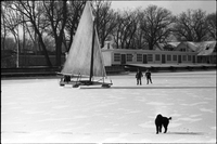 "Two children walking from Algonquin Island to ice boat ""Silver Heels"" out on frozen Lake Ontario, dog in foreground."