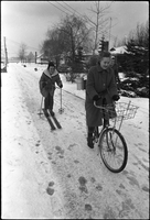Patricia Thom (on bicycle) pulls her friend, Barbara Lye (on skis), along Nottawa Ave. on Algonquin Island.