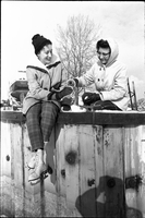 Barbara Lye (left) and another woman, take a break from skating on frozen Lake Ontario off the Toronto Islands.