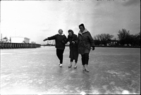 Three women skating on frozen Lake Ontario off the Toronto Islands: Patricia Thom (centre) and Barbara Lye (right).