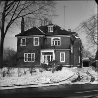 Exterior of 100 Elm Avenue, in the snow.