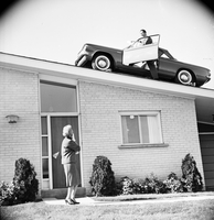 Applewood Hts, Ont. : Cars on roofs of houses